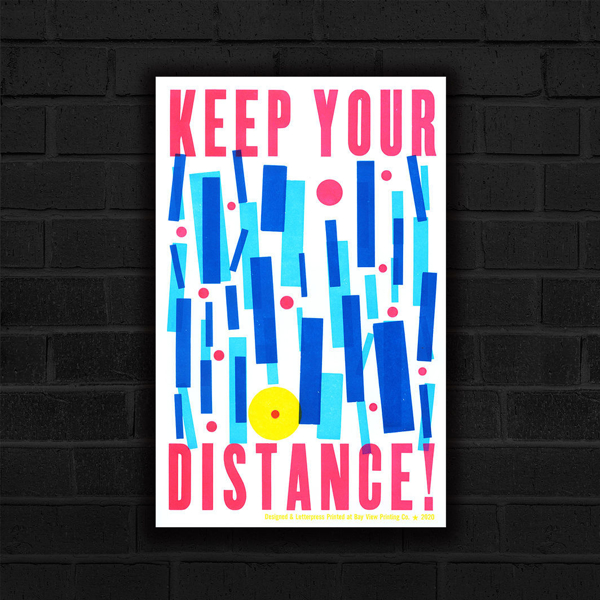 Ashley Town's Keep Your Distance Poster, depicting bright blue and pink blocks that are inentionally spaced and the words Keep Your Distance