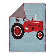 A red Tractor on a pale blue background with red piping with a fold over showing the grey color on the opposite side