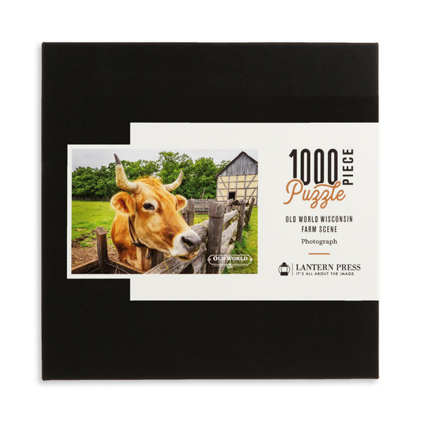 Puzzle box with picture of bovine with horns and old barn in background.