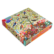 Side angle of puzzle box cover with illustration of colorful birds in a tree.