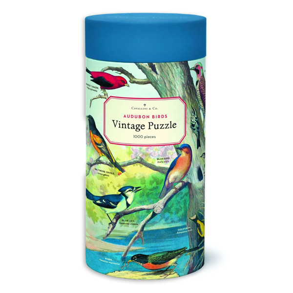 Round tube with vintage image of multiple bird species perched on tree branches. Tanacer, Bluebird, Baltimore Oriole, Robin, and Bluejay are labeled in front of a blue lake.