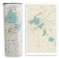 Side view of Madison Lakes thermal travel mug. Off-white background with street lines and light blue lakes in Madison area.